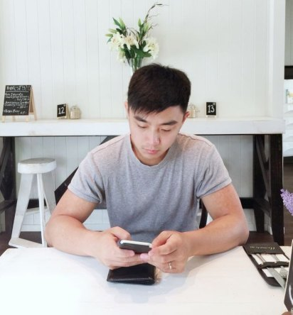 Digital Marketer ,Josiah Lau, publishing social media content.