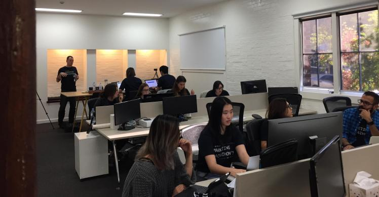 Teams working at Brisbane's first Digital Marketing Hackathon, hosted by Lachlan Kirkwood.