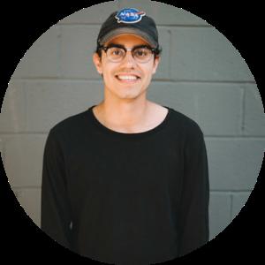 Headshot of Canadian personal branding entrepreneur, Manu (Swish) Goswami.
